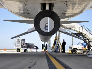 Technicians and engineers at Vandenberg Air Force Base in California mate the Pegasus XL rocket with the Interface Region Imaging Spectrograph, or IRIS