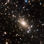 This view of a massive cluster of galaxies unveils a very cluttered-looking universe filled with galaxies near and far